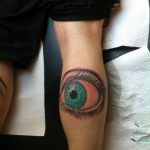 Auge blau Tattoo